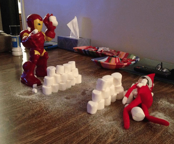 Elf and Iron Man having a snowball fight