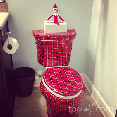 Elf wraps the toilet