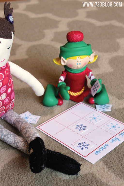 Elf plays tic tac snow