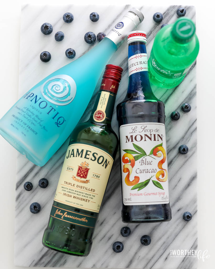 Ingredients needed for a Blue Whiskey Cccktail