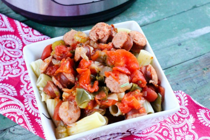 Easy, weeknight dinner idea using an Instapot using Sausage, peppers, onions, celery, mushrooms, tomatoes, and pasta- Sausage Cacciatore. This super easy InstaPot recipe is a winner for the whole family.