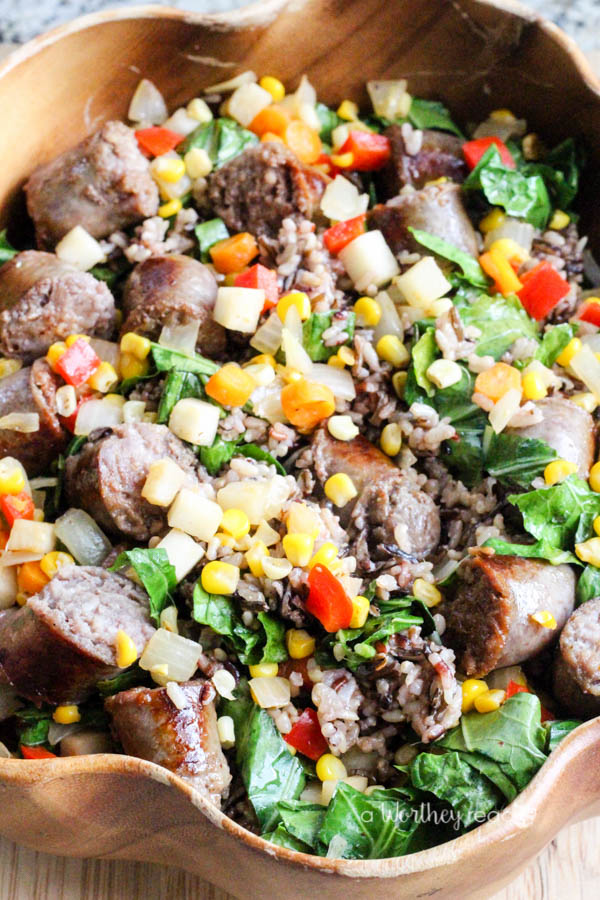 Get dinner on the table quickly with Johnsonville Brats, wild rice, sweet corn kernels, carrots and a few more veggies. This easy dinner idea is not only healthy, but also delicious for the whole family to enjoy! Wild Rice with Brats & Vegetables
