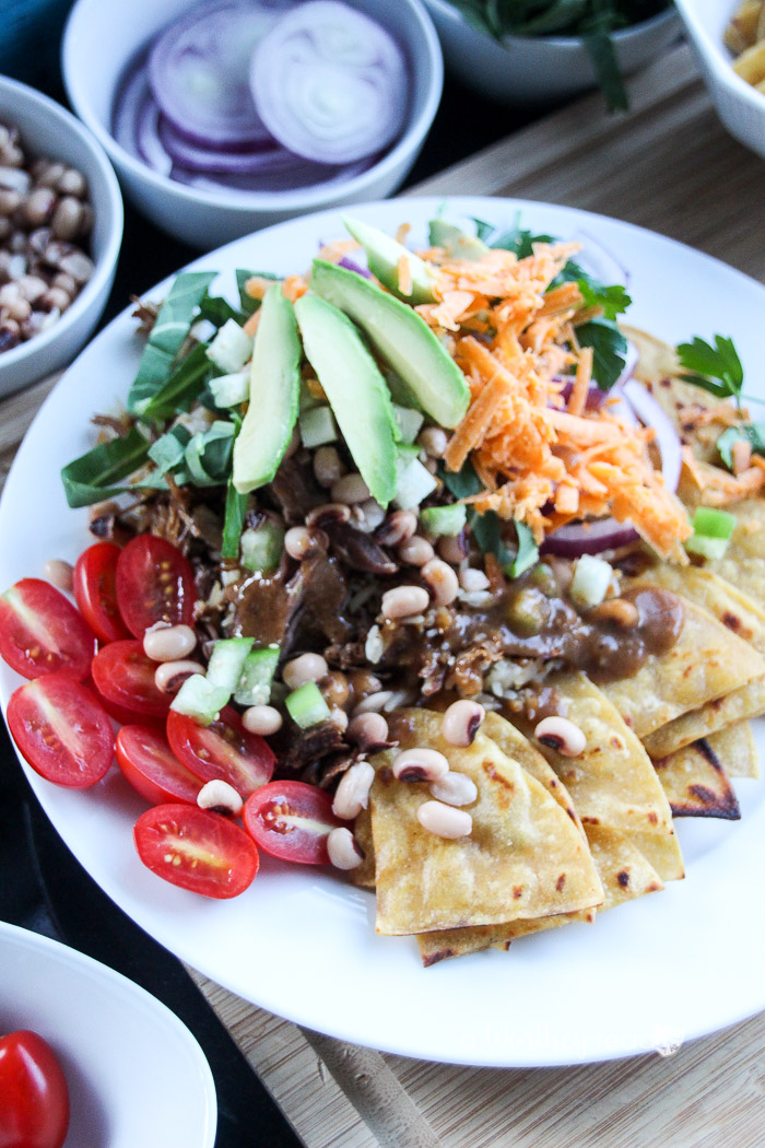 Ring in the New Year with this lucky meal: pork, greens and black eye peas. Plus, it's an easy Nacho recipe you can make any time of the year- Lucky Pork & Black Eye Peas Nachos