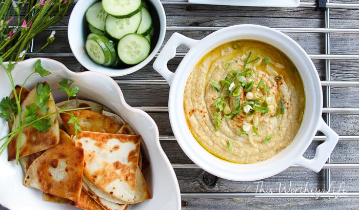 Our Hummus + Artichoke Dip is so easy to make.  Made with chickpeas, tahini, artichokes, and a little slicing, and dicing, then the food processor does the rest. Hummus lovers, unite! Dip it real good!
