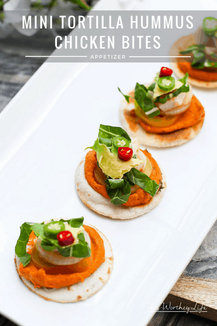 Get ready for game day with our fun appetizer using Sabra's Taco Inspired Hummus, plus chicken, fresh vegetables, laid on a flour tortilla.  This easy appetizer will also be great to serve over the holidays, including Christmas appetizers, and a New Year's Eve party. Plus, when you're getting ready for the Superbowl, this chicken and hummus appetizer will be a crowd favorite!