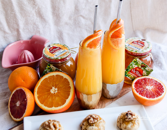Ring in the New Year with a Honey Orange Mimosa Cocktail. Paired with a Honey Walnut Cookie, these recipes are great for parties, a girl's night out, brunch, or breakfast and dessert in bed.