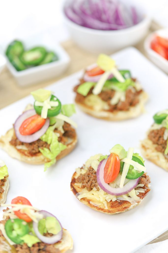 Slider recipes are pretty popular around here. We mixed our regular tacos and sloppy joes' to make Taco Sloppy Joe Sliders. They were a huge hit at our game day party, plus they are easy appetizers to make for any type of party or dinner! Grab the taco sloppy joe sliders recipe down below.