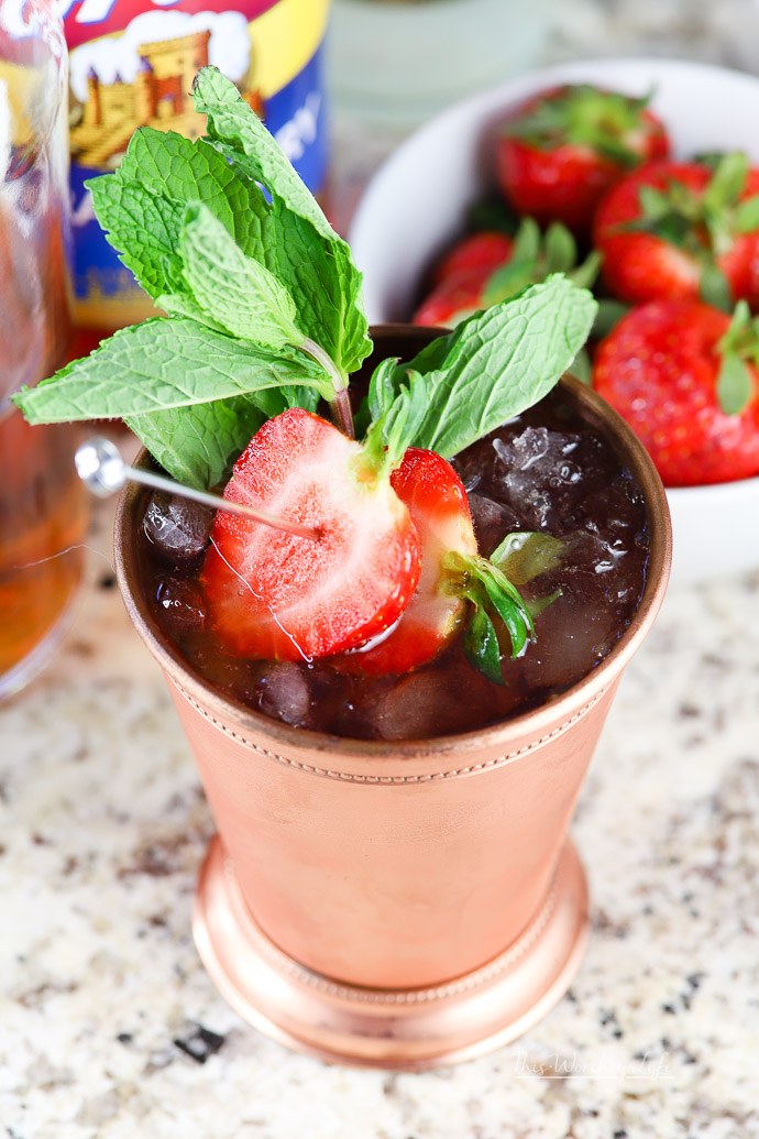 Strawberry Moscow Mule- This is of the perfect time of year to find fresh strawberries. And if you're a fan of bourbon, this Moscow mule recipe is one you will want to give a try! We've taken the classic Moscow Mule and gave it a little twist with simple syrup and fresh strawberries to create a Strawberry Bourbon Moscow Mule.