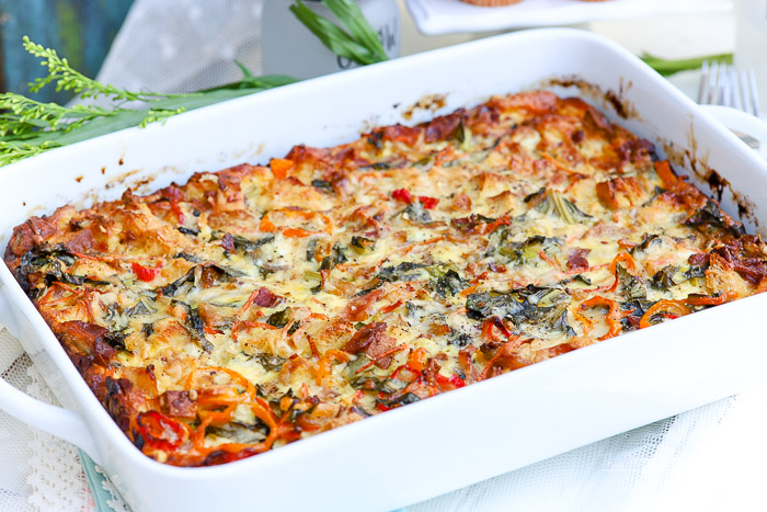 Take breakfast to a new level with our loaded bacon + peppers breakfast strata! Oozing with a variety of cheeses, fresh peppers, thick-cut bacon, collard greens, onions and more, this loadedstratasays, breakfast is served!