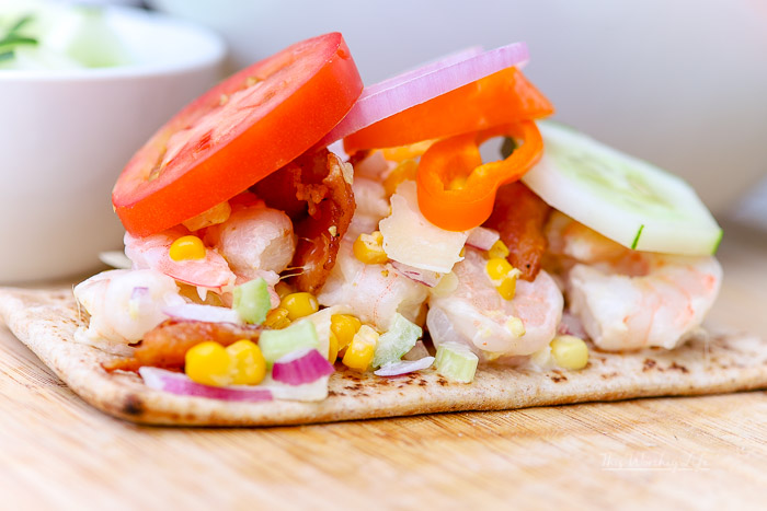 This po' boy sandwich is made with shrimp made with a mixture of mayo, fried sweet corn, diced radish, celery, and parmesan, served on flatbread. This Shrimp Po' Boy is great to serve with a side of Cape Cod chips, the type of appetizer you serve on a summer afternoon, a day at the beach, or just because you're craving a po' boy!