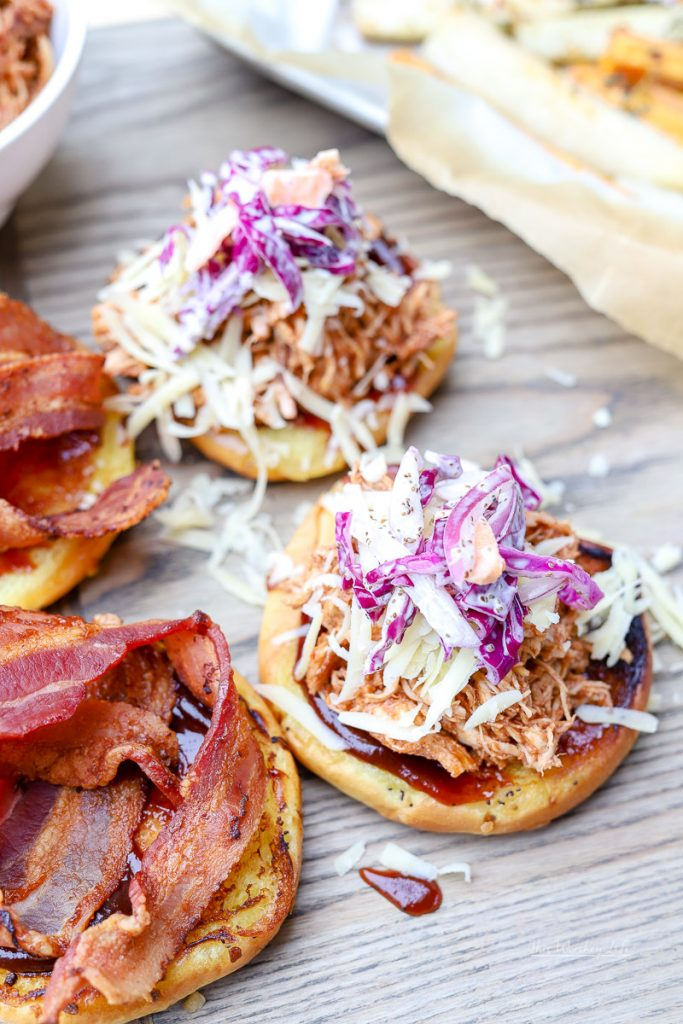BBQ Pulled Chicken Sandwiches are a great appetizer for game day parties, BBQ outings, and any other time when you're feeling in the mood for BBQ chicken. Topped with coleslaw and bacon, you can't go wrong with these Kansas City BBQ Pulled Chicken Sandwiches.