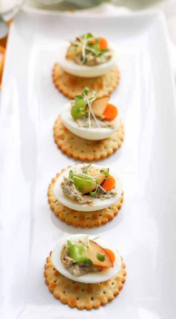 Simple, yet delicious is what we're whipping up and serving as a party appetizer: Chicken Salad Deviled Eggs. We're sharing how to make chicken salad paired with deviled eggs. You can find the recipe down below, and plan to serve this chicken recipe at your next gathering!