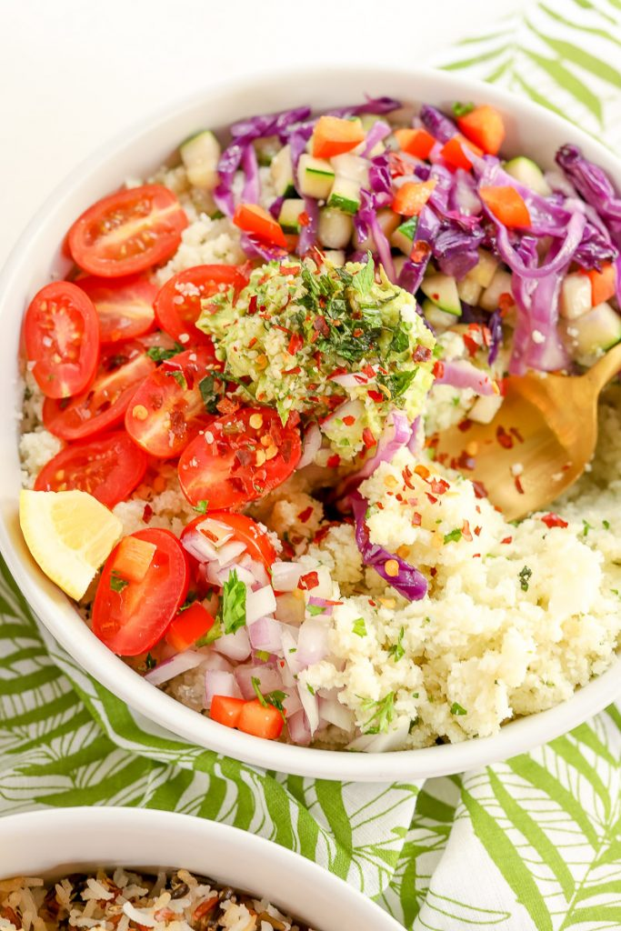 Summertime is all about eating the rainbow! This colorful rice bliss bowl is full of fresh, delicious veggies straight from the garden, grocery store, or your farmer's market. We're sharing two ways to enjoy this bliss bowl, with rice or cauliflower.