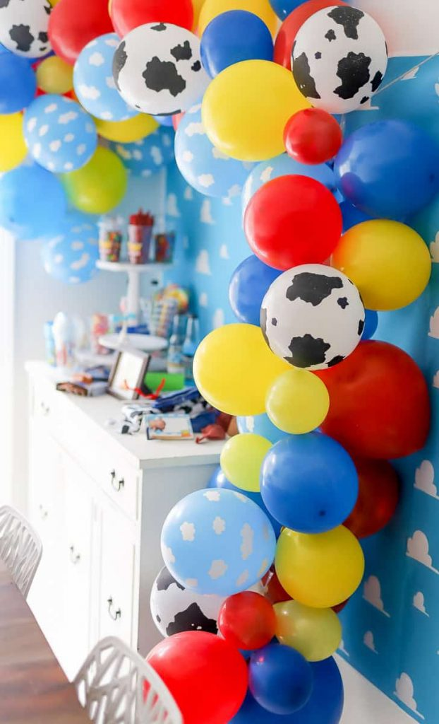 Plan a fun Toy Story themed party with a Toy Story Balloon garland. I'm sharing how to create a balloon garland with a Toy Story theme. It's the perfect pop to any themed party.