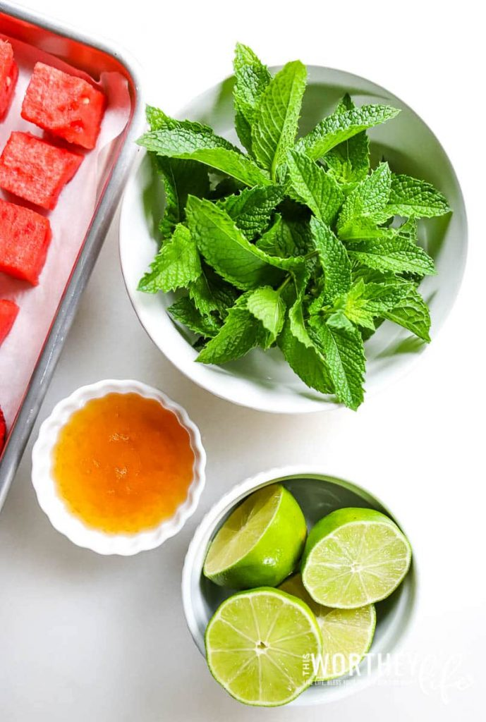 Fresh mint, lime juice, and honey in a flat lay photo
