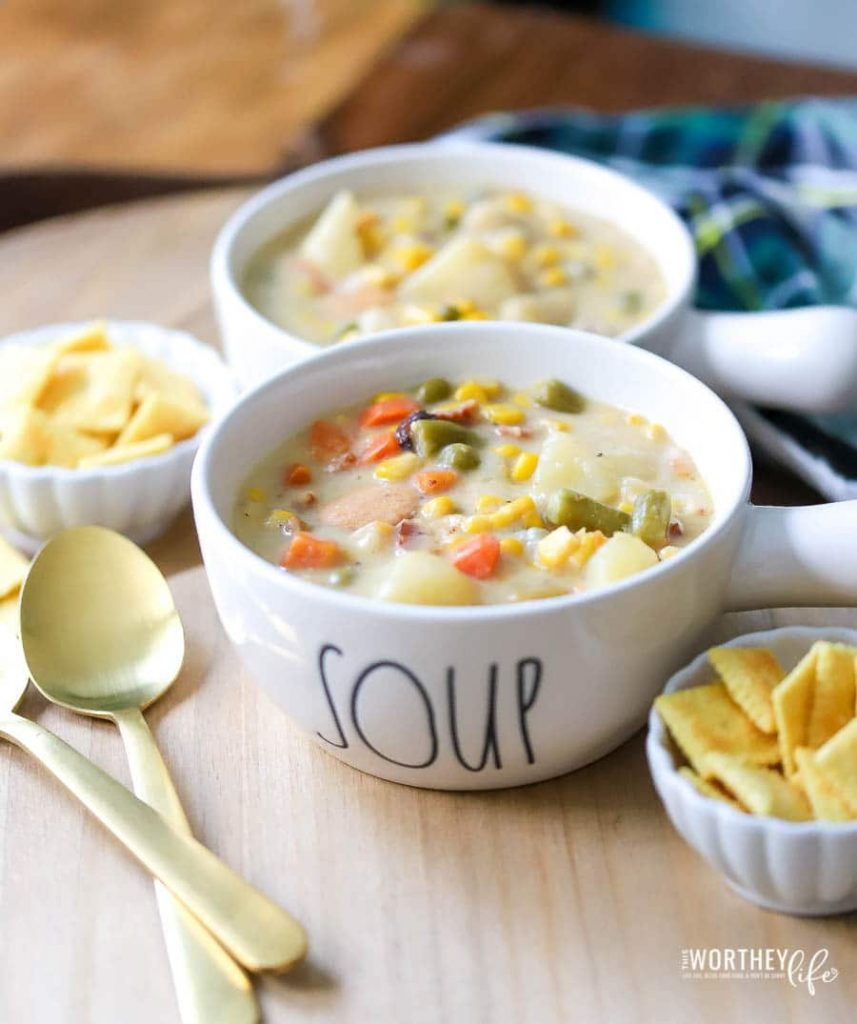Hearty vegetable soup- corn, potato, sausage in a Rae Dunn soup bowl