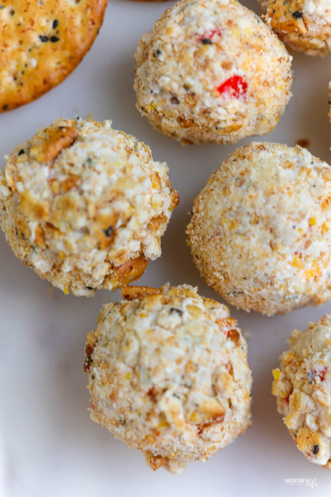 several cheeseballs covered with crumbled multigrain crackers
